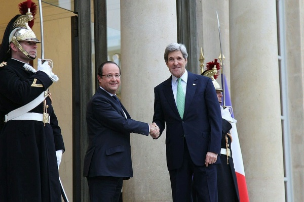 Secretary of State John Kerry shakes hands with French President Francois Hollande upon arrival at Elysee Palace. Photo courtesy of US State Department.