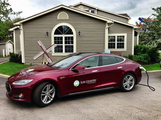 Sun Country Highway's Tesla S Model on tour across New Brunswhick to build EV infrastructure. (CNW Group/Sun Country Highway) Photo courtesy of Sun Country Highway