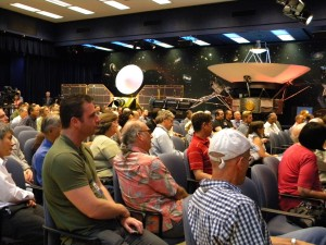 As part of a celebration of 35 years of flight for NASA's Voyager spacecraft, a crowd of engineers and scientists at NASA's Jet Propulsion Laboratory in Pasadena, Calif., gather at von Karman auditorium to listen to insider stories about Voyager. At the top right of the picture is a full-size model of Voyager. Image credit: NASA/JPL-Caltech Courtesy of NASA/JPL