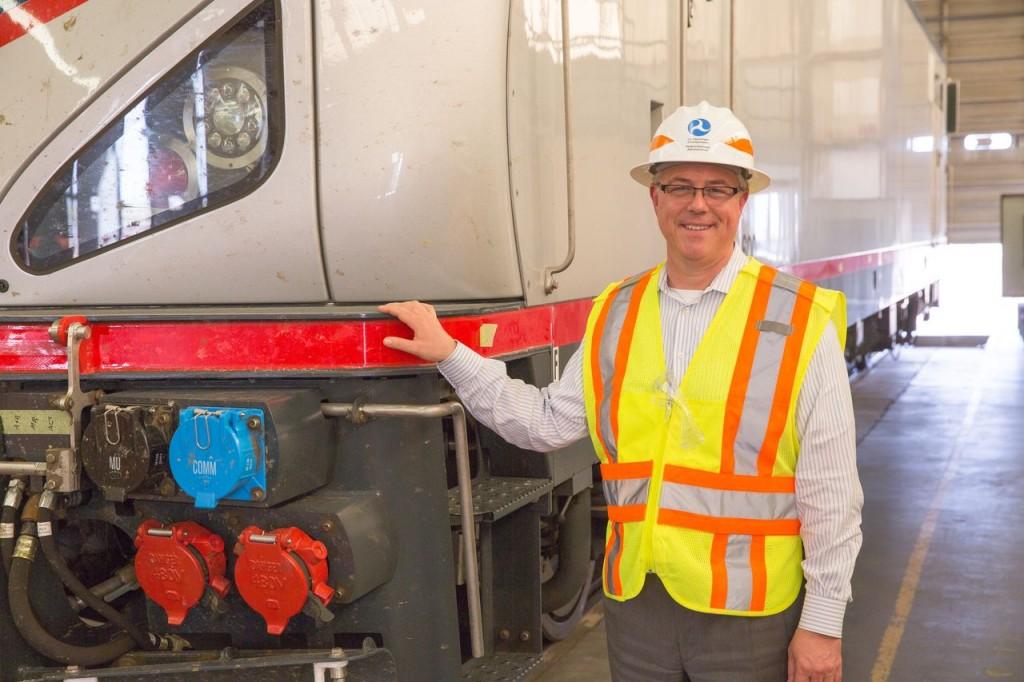 FRA Administrator Szabo stands near Cities Sprinter locomotive at the TTC; photo courtesy Amtrak, Chuck Gomez Courtesy of US DOT