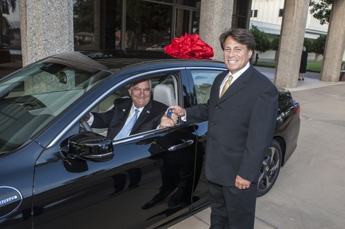 Honda's Steven Center, vice president of the Environmental Business Development Office, presents city of Torrance Mayor Frank Scotto, left, the keys to a 2014 Honda Accord Plug-In as a continued part of Honda's advanced vehicle testing efforts Photo courtesy of Honda