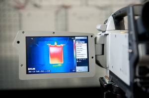 NREL researchers use thermal imaging to evaluate thermal properties of a lithium-ion battery pack.  Photo by Dennis Schroeder, NREL Courtesy of NREL