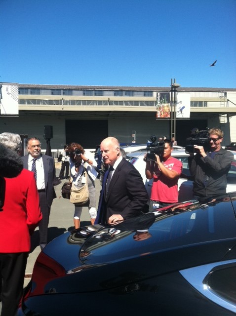 """Governor Brown passing the """"fancy"""" Model S"""