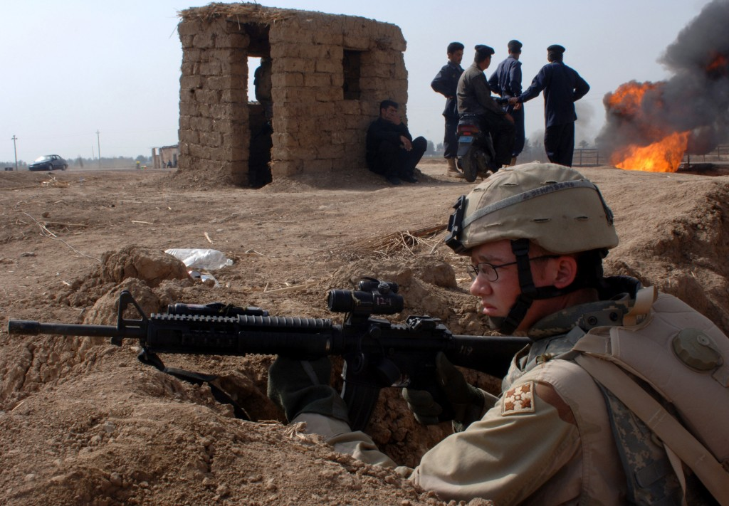 Army Pfc. Mark Hexum provides perimeter security during a reconnaissance patrol at the site of insurgent attack on an oil pipeline near Taji, Iraq, on March 1, 2006. DoD photo by Petty Officer 1st Class Michael Larson, U.S. Navy. Photo courtesy of DOD