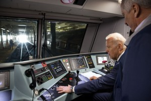 """Vice President Joe Biden sits at the controls of one of Amtrak's new """"Cities Sprinter"""" electric locomotives at the 30th Street Station in Philadelphia, Pa., Feb. 6, 2014. (Official White House Photo by David Lienemann)"""