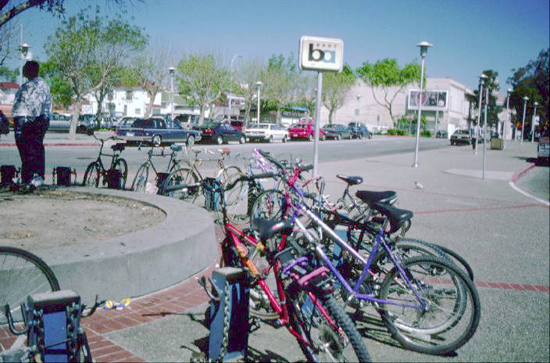 1994, BART required a Bike Permit and these early bike racks at Fruitvale BART did not allow use of a U-Lock. Fruitvale BART now has a Bike Station, secure electronic lockers, and BART has an all hours bikes-on-board policy. Photo courtesy of BART