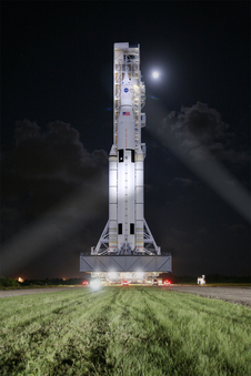 This artist concept shows NASA's Space Launch System, or SLS, rolling to a launchpad at Kennedy Space Center at night. SLS will be the most powerful rocket in history, and the flexible, evolvable design of this advanced, heavy-lift launch vehicle will meet a variety of crew and cargo mission needs. Image credit: NASA/MSFC Courtesy of NASA