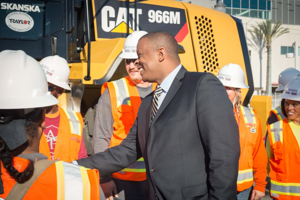 Secretary Anthony Foxx greeting workers who will build the project.