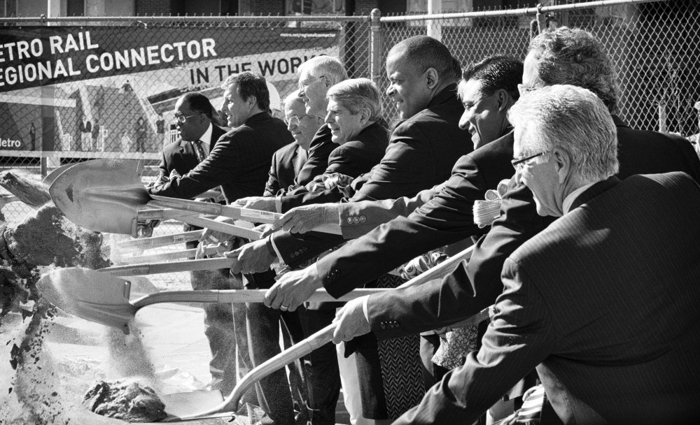 The ceremonial turning of the dirt by U.S. Transportation Secretary Anthony Foxx and local officials.